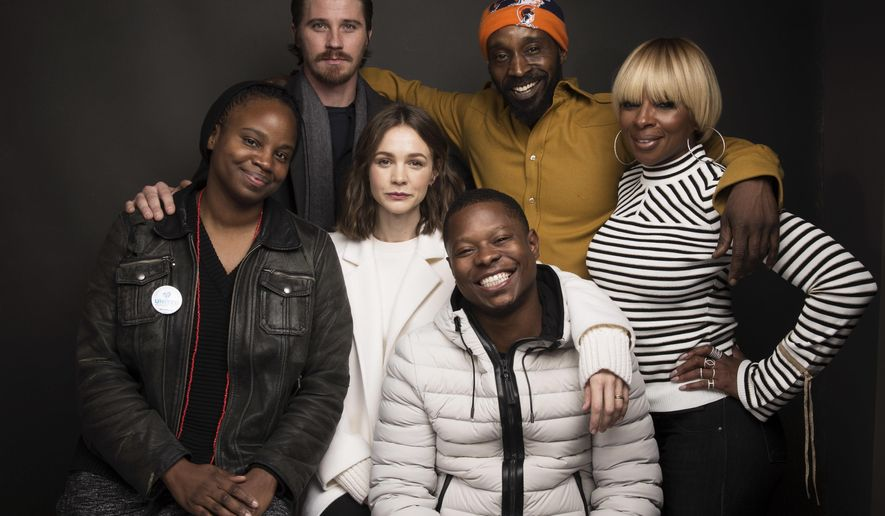 """Director Dee Rees, from left, actors Garrett Hedlund, Rob Morgan, Mary J. Blige, Carrey Mulligan, center, and Jason Mitchell, bottom pose for a portrait to promote the film, """"Mudbound"""", at the Music Lodge during the Sundance Film Festival on Saturday, Jan. 21, 2017, in Park City, Utah. (Photo by Taylor Jewell/Invision/AP)"""