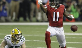 Atlanta Falcons' Julio Jones reacts after catching a pass during the second half of the NFL football NFC championship game against the Green Bay Packers Sunday, Jan. 22, 2017, in Atlanta. (AP Photo/David J. Phillip)