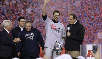 CBS announcer Jim Nantz, right, interviews New England Patriots quarterback Tom Brady, second from right holding the AFC championship trophy, beside team owner Robert Kraft, left, honorary captain Tedy Bruschi, second from left, and head coach Bill Belichick after the AFC championship NFL football game, Sunday, Jan. 22, 2017, in Foxborough, Mass. The Patriots defeated the the Pittsburgh Steelers 36-17 to advance to the Super Bowl. (AP Photo/Matt Slocum)
