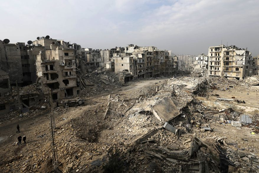 Mounds of rubble used to be high-rise apartment buildings in the once rebel-held Ansari neighborhood in eastern Aleppo, Syria. Residents have been evacuated and are now refugees. (Associated Press)