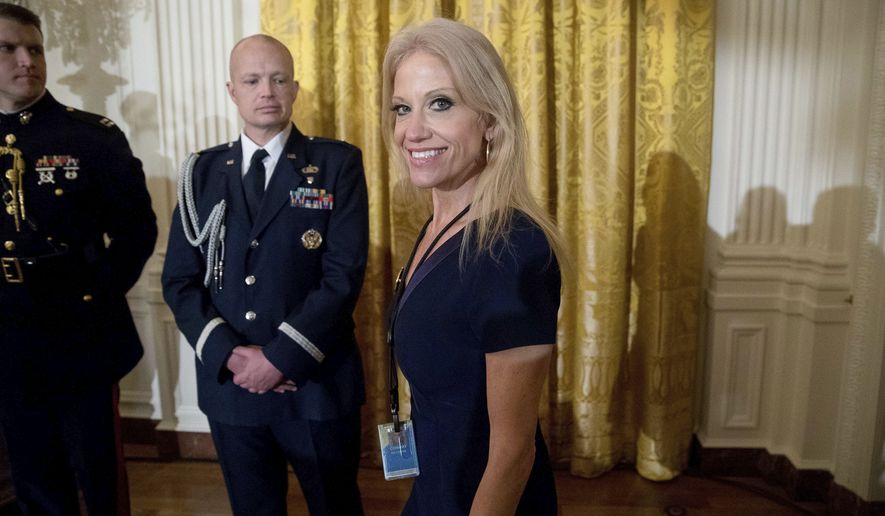 Counselor to the President Kellyanne Conway, center, arrives for a White House senior staff swearing in ceremony in the East Room of the White House, Sunday, Jan. 22, 2017, in Washington. (AP Photo/Andrew Harnik)