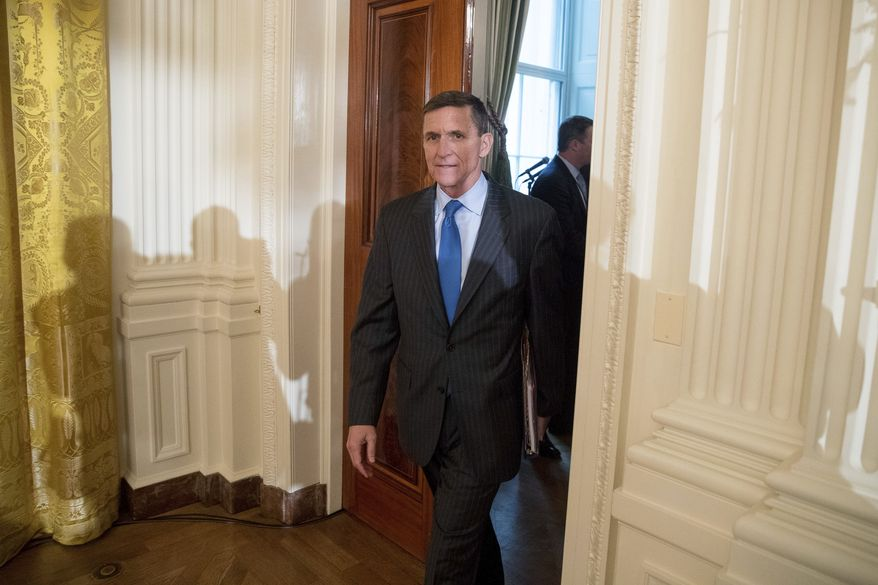 National Security Adviser Michael Flynn arrives for a White House senior staff swearing in ceremony in the East Room of the White House, Sunday, Jan. 22, 2017, in Washington. (AP Photo/Andrew Harnik)
