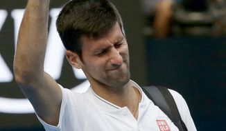 Serbia's Novak Djokovic gestures to the crowd after losing to Uzbekistan's Denis Istomin during their second round match at the Australian Open tennis championships in Melbourne, Australia, Thursday, Jan. 19, 2017. (AP Photo/Mark Baker)