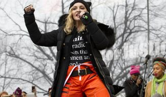 Madonna performs on stage during the Women's March rally, Saturday, Jan. 21, 2017, in Washington. Madonna, Julia Roberts, Scarlett Johansson, Cher, Alicia Keys, Katy Perry, Emma Watson, Amy Schumer, Jake Gyllenhaal and feminist leader Gloria Steinem were just some of those Hollywood A-list celebrities in attendance at the march in Washington. (AP Photo/Jose Luis Magana)