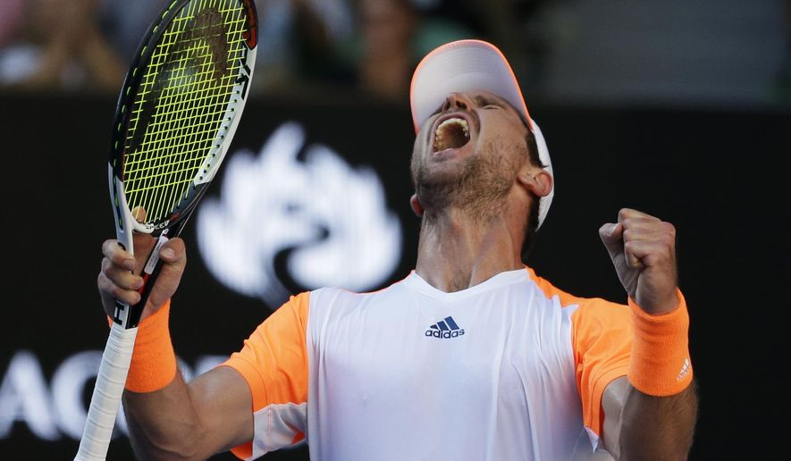 Germany's Mischa Zverev celebrates his victory over Britain's Andy Murray during their fourth round match at the Australian Open tennis championships in Melbourne, Australia, Sunday, Jan. 22, 2017. (AP Photo/Aaron Favila)