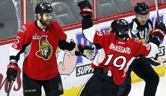 Ottawa Senators' Zack Smith (15) celebrates his goal against the Columbus Blue Jackets with teammate Derick Brassard (19) during first period NHL hockey action in Ottawa, Ontario, Sunday, Jan. 22, 2017. (Fred Chartrand/The Canadian Press via AP)