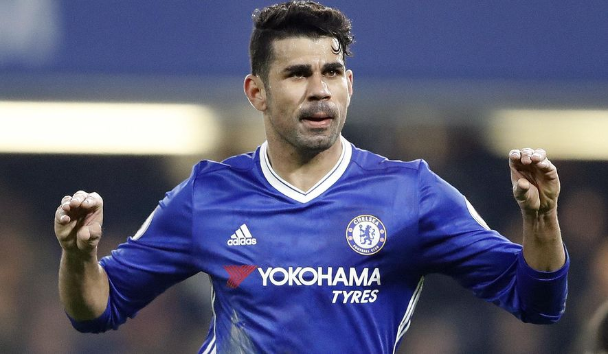 Chelsea's Diego Costa celebrates with teammates after scoring during the English Premier League soccer match between Chelsea and Hull City at Stamford Bridge stadium in London, Sunday, Jan. 22, 2017. (AP Photo/Frank Augstein)