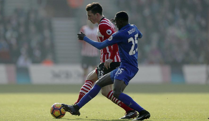 Southampton's Pierre-Emile Hojbjerg, left, and Leicester City's Wilfred Ndidi battle for the ball during the English Premier League soccer match between Southampton and Leicester City at St Mary's, Southampton, England, Sunday, Jan. 22, 2017.(David Davies/PA via AP)