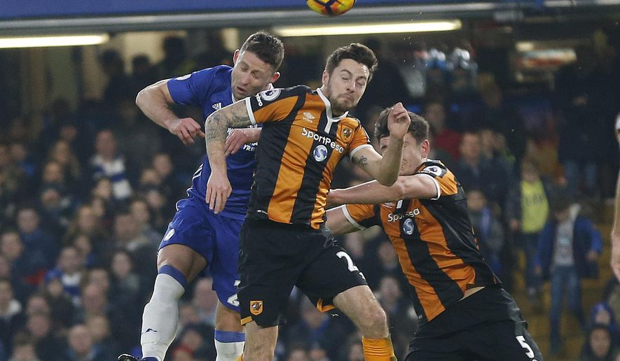 Chelsea's Gary Cahill, left, and Hull City's Ryan Mason and Hull City's Harry Maguire challenge for the ball during the English Premier League soccer match between Chelsea and Hull City at Stamford Bridge stadium in London, Sunday, Jan. 22, 2017.(AP Photo/Frank Augstein)