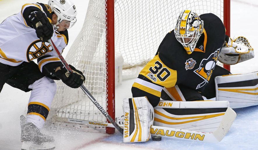 Pittsburgh Penguins goalie Matt Murray (30) stops a shot by Boston Bruins' Brad Marchand (63) in the first period of an NHL hockey game in Pittsburgh, Sunday, Jan. 22, 2017. (AP Photo/Gene J. Puskar)