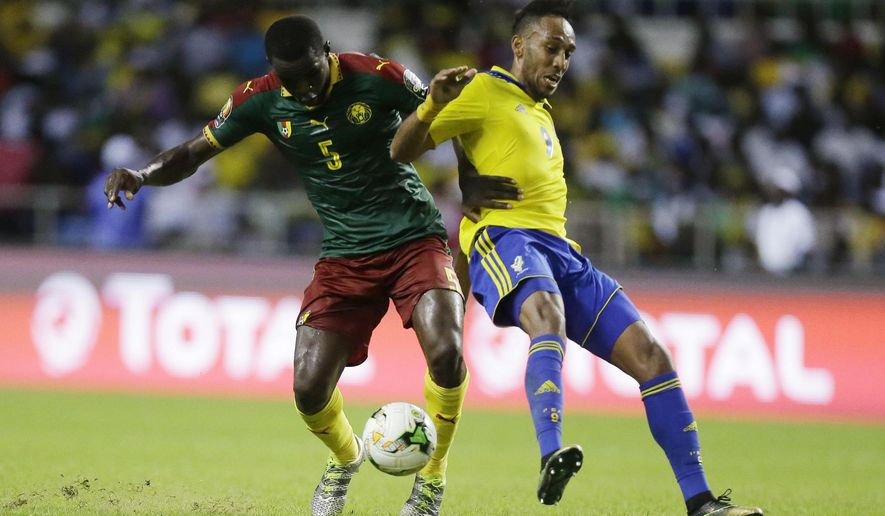 Gabon's Pierre Emerick Aubameyang, right, is challenged by Cameroon's Ngadue Ngadjui Michael, during the African Cup of Nations Group A soccer match between Gabon and Cameroon at the Stade de l'Amitie, in Libreville, Gabon, Sunday Jan. 22, 2017. (AP Photo/Sunday Alamba)