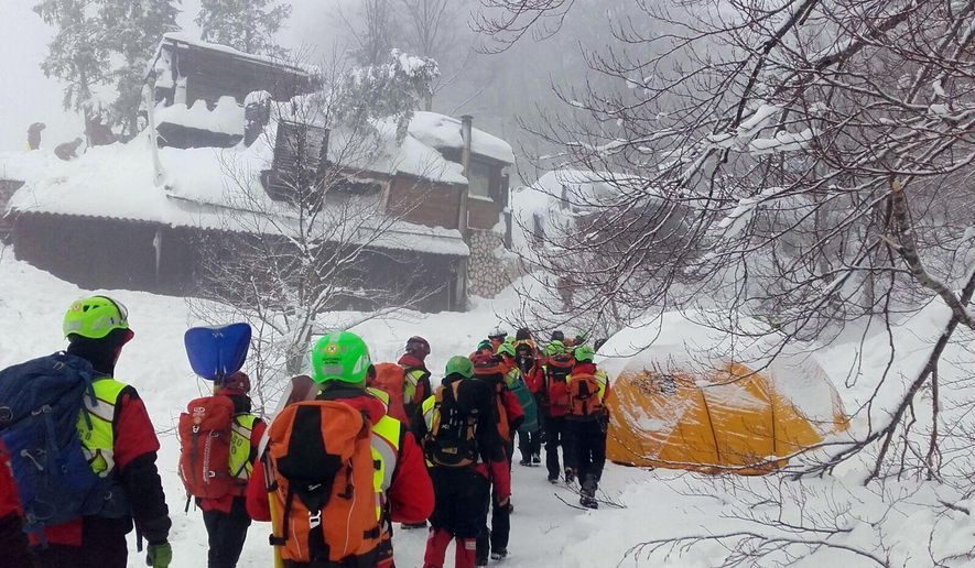 """In this undated photo released Sunday, Jan. 22, 2017, rescuers work in the area of the avalanche-hit Rigopiano hotel, central Italy.  After two days huddled in freezing cold, tons of snow surrounding them in the wreckage of the avalanche-demolished hotel, survivors greeted their rescuers Friday as """"angels."""" Among the 10 people pulled out alive was a plucky 6-year-old who just wanted her favorite cookies. (Corpo Nazionale Soccorso Alpino e Speleologico/The National Alpine Cliff and Cave Rescue Corps (CNSAS) via AP)"""