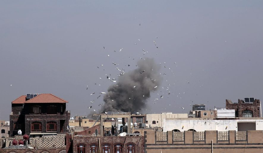 Debris and smoke rise after a Saudi-led airstrike hit an army base, in Sanaa, Yemen, on Jan. 22, 2017. (Associated Press) ** FILE **