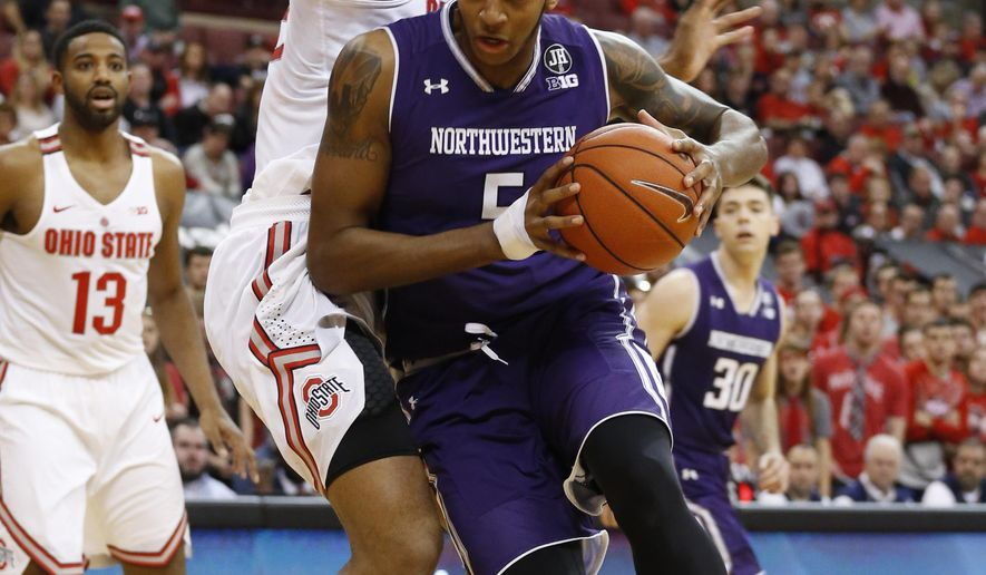 Northwestern's Dererk Pardon, front, drives to the basket against Ohio State's Trevor Thompson during the first half of an NCAA college basketball game Sunday, Jan. 22, 2017, in Columbus, Ohio. (AP Photo/Jay LaPrete)