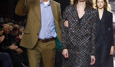 British fashion designer Paul Smith acknowledges applause at the end of his Men fall-winter 2017-2018 fashion collection presented in Paris, Sunday, Jan. 22, 2017. (AP Photo/Francois Mori)