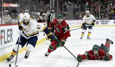 Nashville Predators center Mike Ribeiro (63) has the puck against Minnesota Wild's Jason Zucker (16) and Eric Staal (12) during the second period of an NHL hockey game, Sunday, Jan. 22, 2017, in St. Paul, Minn. (AP Photo/Hannah Foslien)