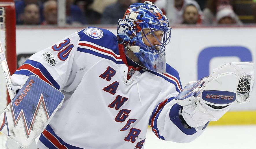 New York Rangers goalie Henrik Lundqvist (30) stops a Detroit Red Wings shot in the second period of an NHL hockey game Sunday, Jan. 22, 2017, in Detroit. (AP Photo/Paul Sancya)