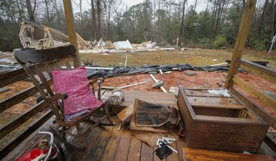 The porch is all that is left standing at a home on Lockhart Trailer Court Road in Lauderdale, Miss., Sunday, Jan. 22, 2017. Several homes in Lauderdale County were damaged or destroyed after a tornado ripped through the area late Saturday. (Paula Merritt/The Meridian Star via AP)