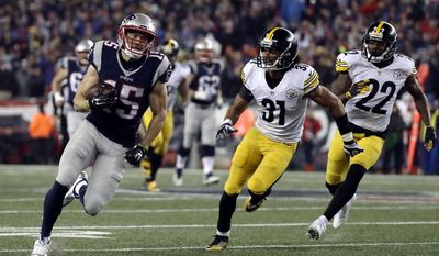 New England Patriots wide receiver Chris Hogan (15) runs from Pittsburgh Steelers cornerbacks Ross Cockrell (31) and William Gay (22) after catching a pass during the second half of the AFC championship NFL football game, Sunday, Jan. 22, 2017, in Foxborough, Mass. (AP Photo/Matt Slocum)