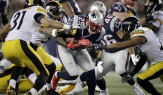 New England Patriots running back LeGarrette Blount (29) runs against the Pittsburgh Steelers defense during the second half of the AFC championship NFL football game, Sunday, Jan. 22, 2017, in Foxborough, Mass. (AP Photo/Charles Krupa)