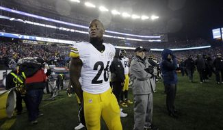 Pittsburgh Steelers running back Le'Veon Bell watches from the sideline as he waits for the end of the AFC championship NFL football game against the New England Patriots, Sunday, Jan. 22, 2017, in Foxborough, Mass. The Patriots won 36-17 to advance to the Super Bowl. (AP Photo/Steven Senne)