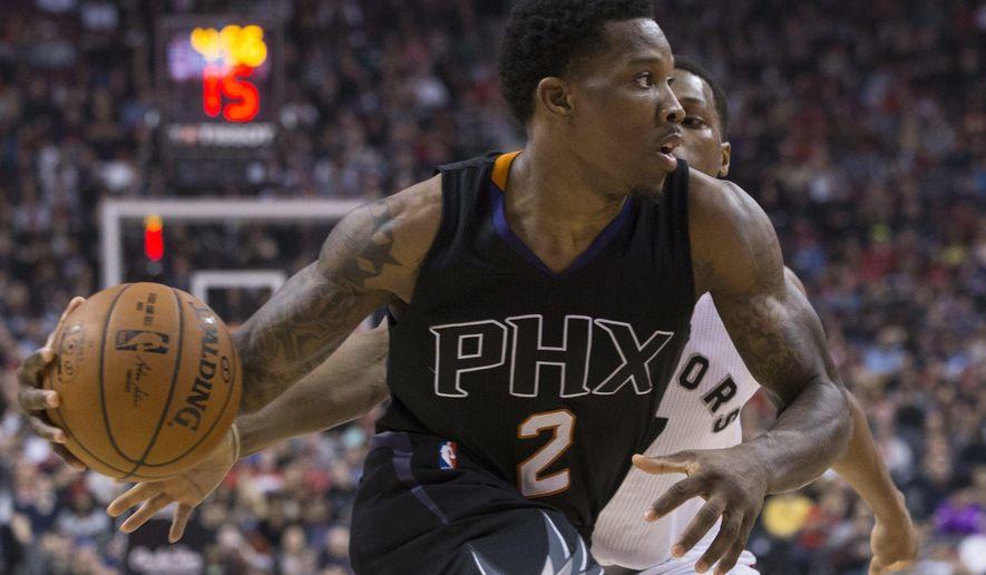Phoenix Suns guard Eric Bledsoe (2) drives past Toronto Raptors guard Kyle Lowry during first-half NBA basketball game action in Toronto, Sunday, Jan. 22, 2017. (Chris Young/The Canadian Press via AP)