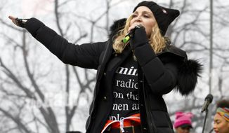 Madonna performs on stage during the Women's March rally, Saturday, Jan. 21, 2017, in Washington. Madonna, Julia Roberts, Scarlett Johansson, Cher, Alicia Keys, Katy Perry, Emma Watson, Amy Schumer, Jake Gyllenhaal and feminist leader Gloria Steinem were some of the Hollywood A-list celebrities in attendance at the march in Washington. (AP Photo/Jose Luis Magana)