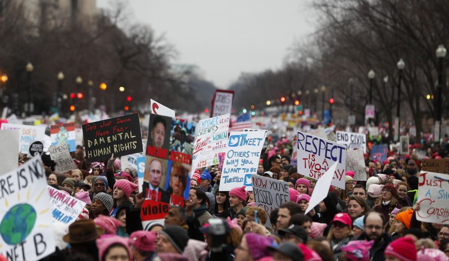 Protesters move along Constitution Avenue at the Women's March on Washington during the first full day of Donald Trump's presidency, Saturday, Jan. 21, 2017 in Washington.  (AP Photo/John Minchillo)