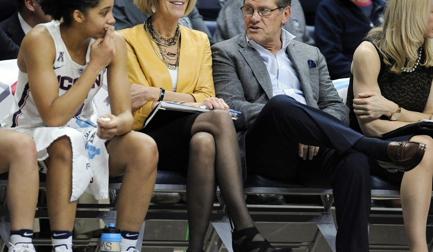 Connecticut head coach Geno Auriemma, third from left, talks with player Gabby Williams, left, as associate head coach Chris Daily, center, listens in the second half of an NCAA college basketball game against Tulane, Sunday, Jan. 22, 2017, in Storrs, Conn. (AP Photo/Jessica Hill)