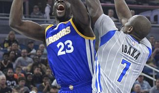 Golden State Warriors forward Draymond Green (23) is fouled by Orlando Magic forward Serge Ibaka (7) while going up for a shot during the first half of an NBA basketball game in Orlando, Fla., Sunday, Jan. 22, 2017. (AP Photo/Phelan M. Ebenhack)