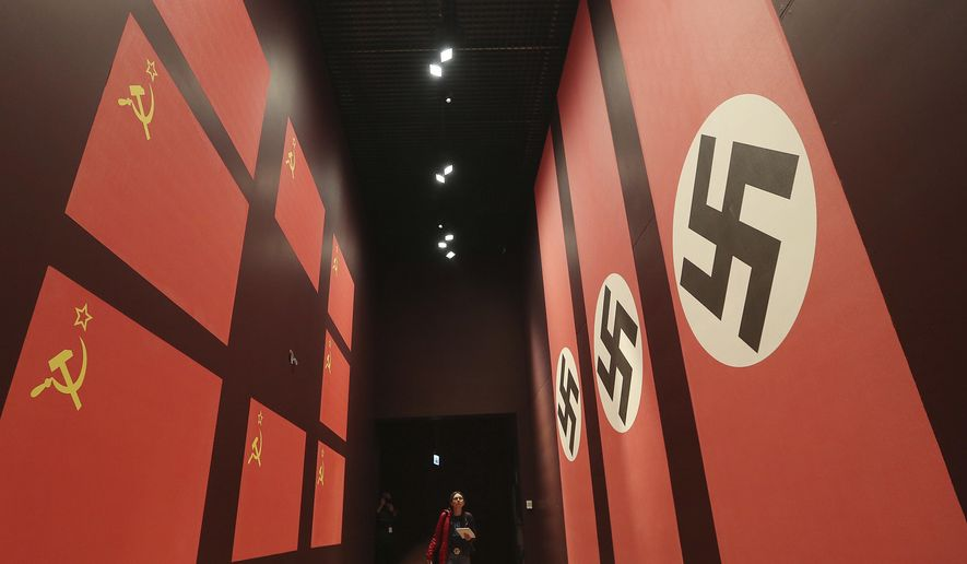 A  woman  looks at an exhibit in the Museum of the Second World War, an ambitious new museum under creation for nine years has opened its doors for a day to historians, museums and reporters in Gdansk, Poland, on Monday, Jan. 23, 2017.  (AP Photo/Czarek Sokolowski)