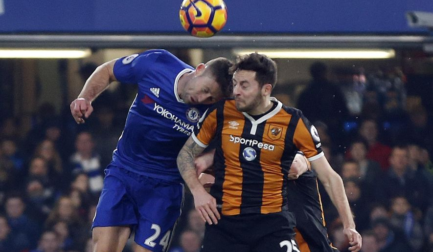 In this Sunday, Jan. 22, 2017 photo, Hull City's Ryan Mason, right, is injured during a header with Chelsea's Gary Cahill, left, during their English Premier League soccer match at Stamford Bridge stadium in London. Hull midfielder Mason underwent surgery after fracturing his skull during a clash of heads during a Premier League match at Chelsea on Sunday. (AP Photo/Frank Augstein)