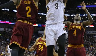 New Orleans Pelicans forward Terrence Jones (9) drives against Cleveland Cavaliers guard Kyrie Irving (2) and guard Iman Shumpert (4) during the first half of an NBA basketball game Monday, Jan. 23, 2017, in New Orleans. (AP Photo/Jonathan Bachman)