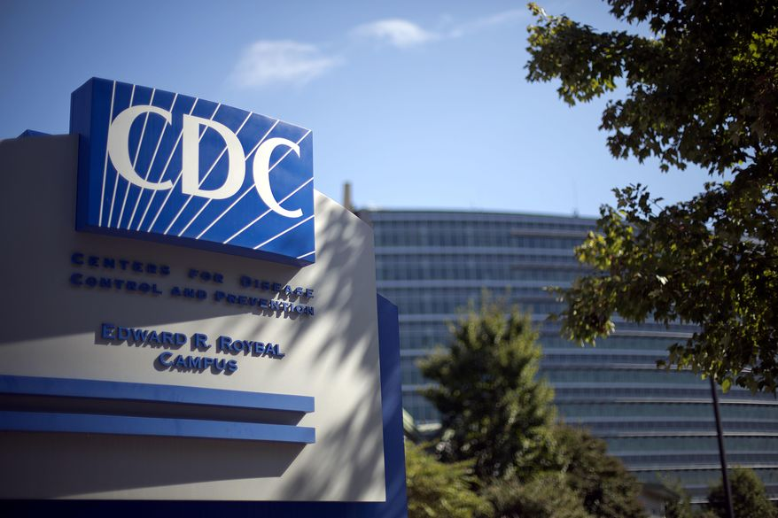 In this Oct. 8, 2013, file photo, a sign marks the entrance to the federal Centers for Disease Control and Prevention (CDC) in Atlanta. (AP Photo/David Goldman, File) **FILE**