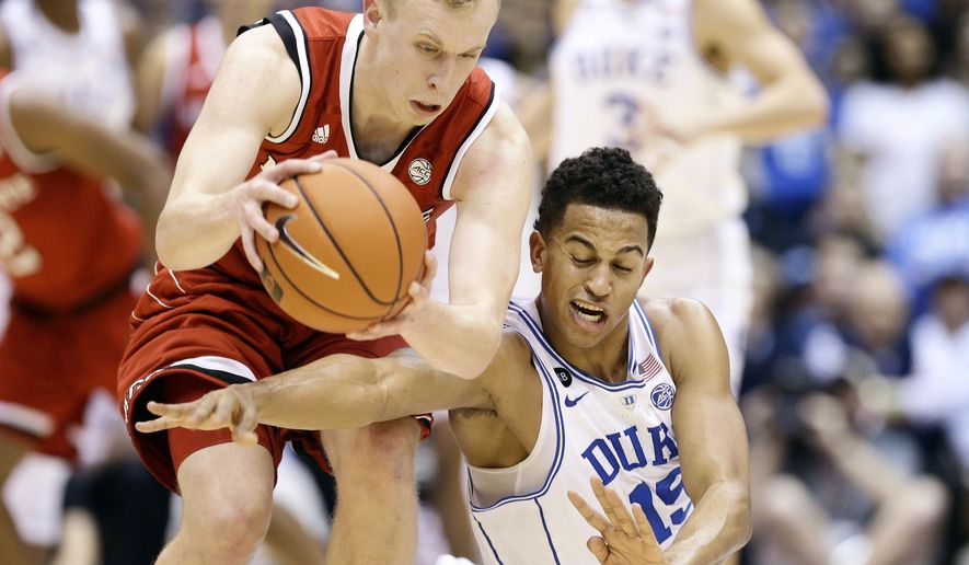 N.C. State's Maverick Rowan, left, and Duke's Frank Jackson (15) chase a loose ball during the first half of an NCAA college basketball game in Durham, N.C., Monday, Jan. 23, 2017. (AP Photo/Gerry Broome)