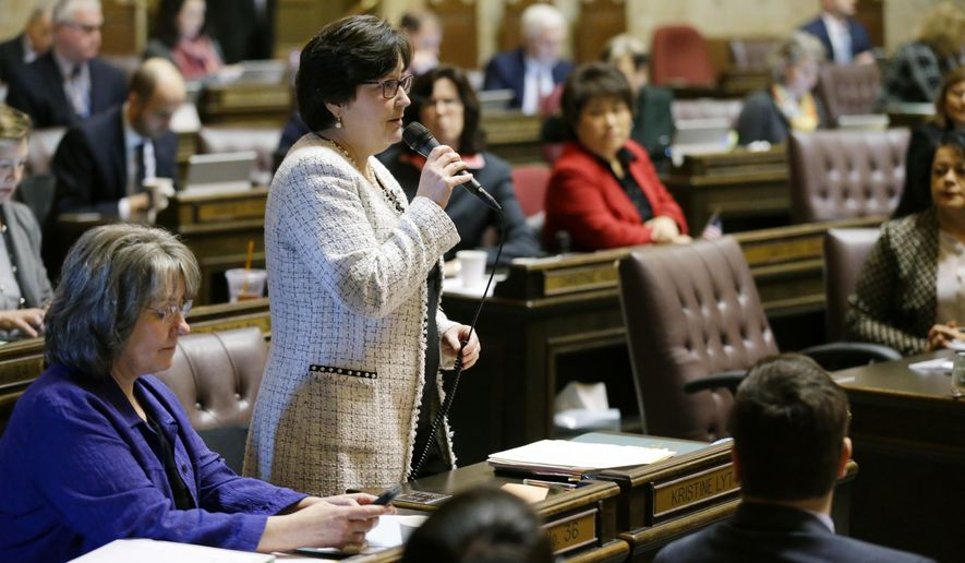Rep. Kristine Lytton, D-Anacortes, speaks on the House floor, Monday, Jan. 23, 2017, at the Capitol in Olympia, Wash. The House passed a bill Monday that delays a deadline for a reduction in the amount of money school districts can collect through local property tax levies, and it now heads to the Republican-controlled Senate. (AP Photo/Ted S. Warren)