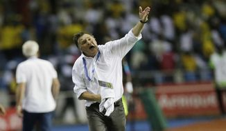 Gabon's soccer team Coach, Jose Antonio Camacho, give instructions during the African Cup of Nations Group A soccer match between Gabon and Cameroon at the Stade de l'Amitie, in Libreville, Gabon, Sunday Jan. 22, 2017. (AP Photo/Sunday Alamba)