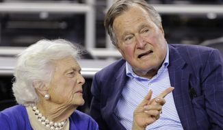 In this March 29, 2015, file photo, former President George H.W. Bush and his wife, Barbara Bush, speak at a college basketball game in Houston. (AP Photo/David J. Phillip, File)