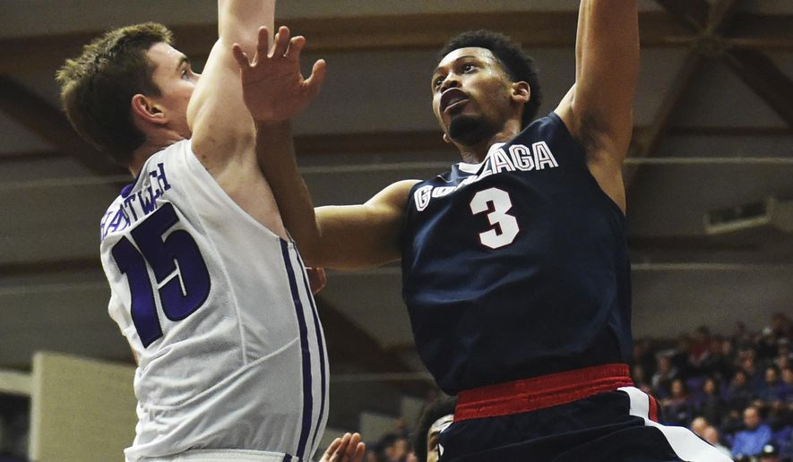 Gonzaga forward Johnathan Williams puts up a shot on Portland center Philipp Hartwich during the second half of an NCAA college basketball game in Portland, Ore., Monday, Jan. 23, 2017. Gonzaga won 83-64. (AP Photo/Steve Dykes)