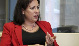 FILE - This Monday, May 4, 2015, file photo New Mexico Public Education Secretary Hanna Skandera discusses the results of teacher evaluations during an interview in Albuquerque N.M. Skandera said policies advocated by Gov Susana Martinez must be enacted or the state's high school graduation rates could fall after hitting record levels. Skandera told The Associated Press lawmakers should pass the governor's third-grade retention proposal in order to halt future high school students from dropping out. (AP Photo/Susan Montoya Bryan, File)