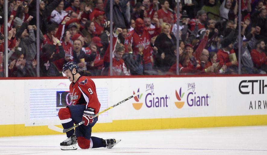 Washington Capitals defenseman Dmitry Orlov (9), of Russia, celebrates his goal during the second period of an NHL hockey game against the Carolina Hurricanes, Monday, Jan. 23, 2017, in Washington. (AP Photo/Nick Wass)