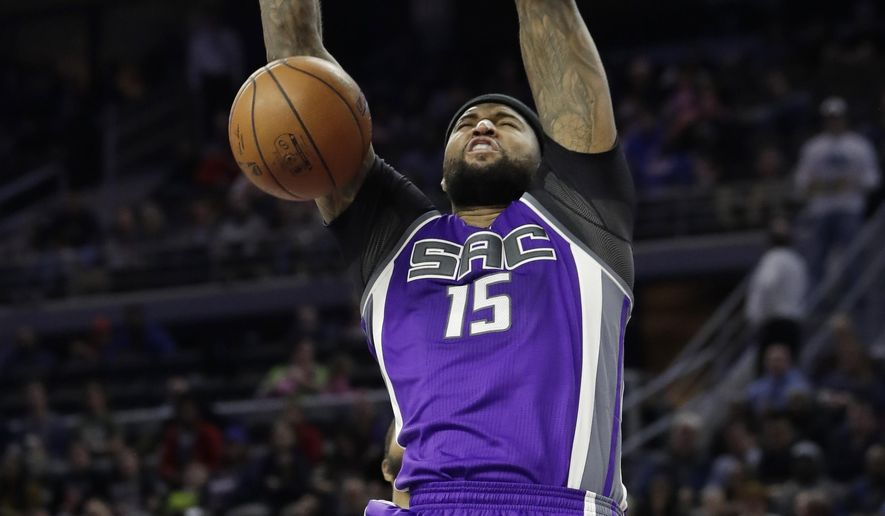Sacramento Kings forward DeMarcus Cousins dunks during the first half of an NBA basketball game against the Detroit Pistons, Monday, Jan. 23, 2017, in Auburn Hills, Mich. (AP Photo/Carlos Osorio)
