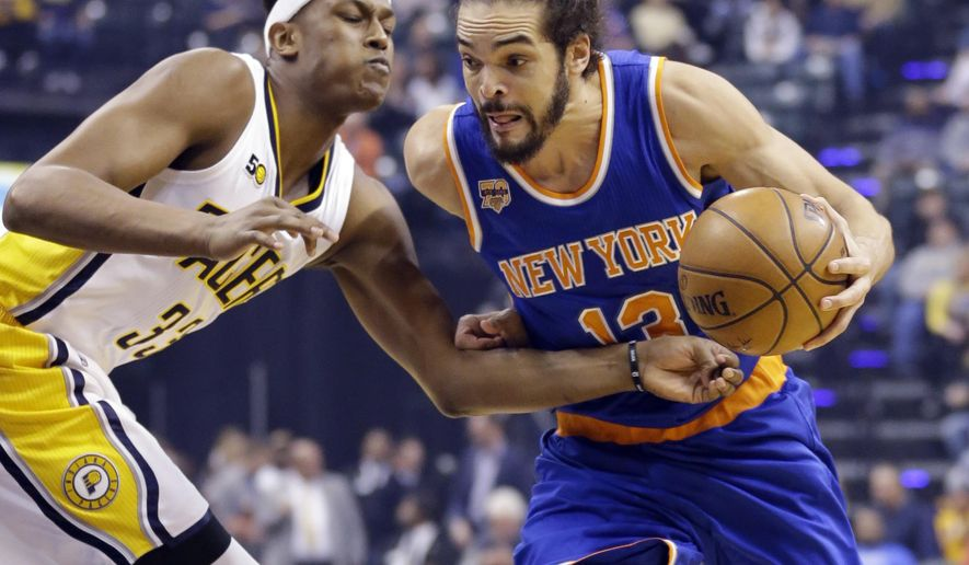New York Knicks center Joakim Noah (13) drives on Indiana Pacers center Myles Turner (33) during the first half of an NBA basketball game in Indianapolis, Monday, Jan. 23, 2017. (AP Photo/Michael Conroy)