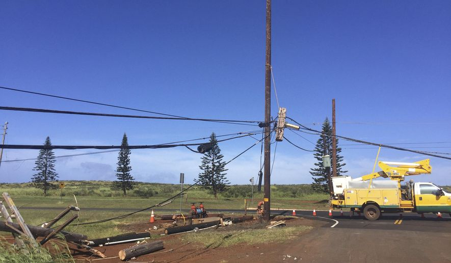 In this Sunday, Jan. 22, 2017, photo, Damage from a recent storm is shown in this photo provided by Maui Electric Company on the island of Lanai, Hawaii. The entire island of Lanai remained without electrical service Monday, after strong winds snapped and damaged utility poles over the weekend. (Maui Electric Company via AP)