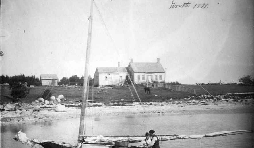 In this 1891 photo released by the National Oceanic and Atmospheric Administration, Penobscot Bay fishermen clean mackerel near their saltwater farm off the Maine coast. Scientists with the University of Massachusetts and other institutions made the findings while conducting research about a long-ago climate calamity in New England that was caused by the eruption of Mount Tambora in Indonesia in 1815. (NOAA/National Oceanic and Atmospheric Administration via AP)