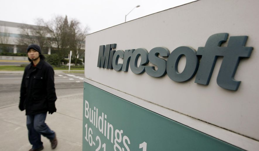In this Jan. 22, 2009, file photo, a man walks on the Microsoft headquarters campus in Redmond, Wash. (AP Photo/Elaine Thompson, File)