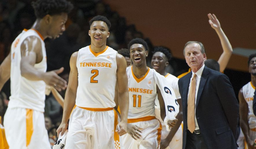 Tennessee's Grant Williams (2), Kyle Alexander (11) and coach Rick Barnes react after Robert Hubbs III (3) made a 3-pointer against Mississippi State during an NCAA college basketball game in Knoxville, Tenn., Saturday, Jan. 21, 2017. (Calvin Mattheis/Knoxville News Sentinel via AP)