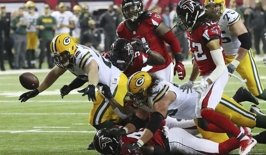Green Bay Packers' Aaron Ripkowski fumbles the ball during the first half of the NFL football NFC championship game against the Atlanta Falcons, Sunday, Jan. 22, 2017, in Atlanta. (Curtis Compton/Atlanta Journal-Constitution via AP)