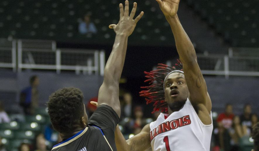 FILE - In this Dec. 25, 2016, file photo, Illinois State guard Paris Lee (1) shoots the basketball as Tulsa forward Junior Etou (0) attempts to block Lee's shot during the second half of an NCAA college basketball game at the Diamond Head Classic in Honolulu. Wichita State's reign atop the Missouri Valley might be in jeopardy.  Illinois State is alone in first in the Valley _ a game up on the Shockers _ thanks largely to a suffocating defense. (AP Photo/Eugene Tanner, File)