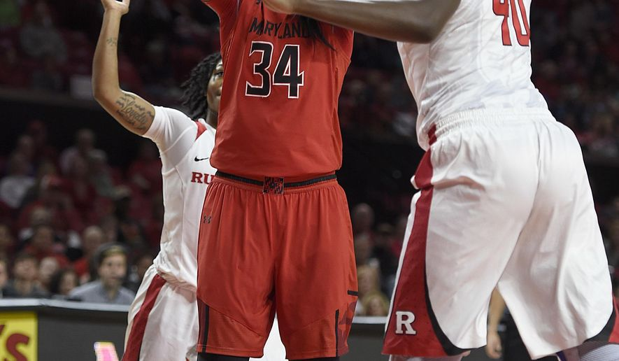 Maryland's Brianna Jones, left, shoots as Rutgers' Victoria Harris defends during the second half of an NCAA college basketball game, Sunday, Jan. 22, 2017, in College Park, Md. (AP Photo/Gail Burton)